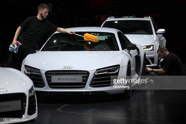 Employees clean an Audi AG R8 V10 plus automobile ahead of the opening day of the Paris Motor Show in Paris France on Wednesday Sept 26 2012 The...