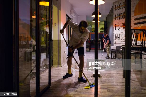 Employees clean the floor of the Will Burger restaurant ahead of opening following the easing of lockdown in Istanbul Turkey on Monday June 1 2020...