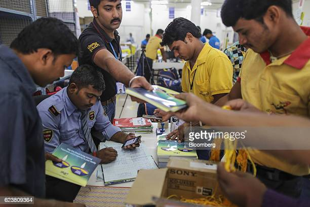 Employees collect Diwali greeting cards at a security desk ahead of delivery at the Flipkart Online Services Pvt office in the Jayaprakash Narayan...