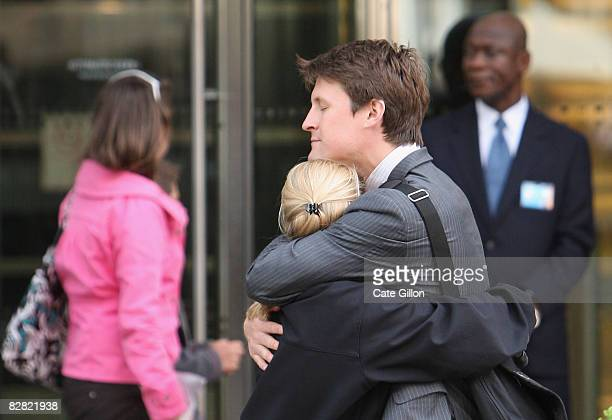 Employees comfort each other outside Lehman Brothers' Canary Wharf office on September 15, 2008 in London, England. The fourth largest American...