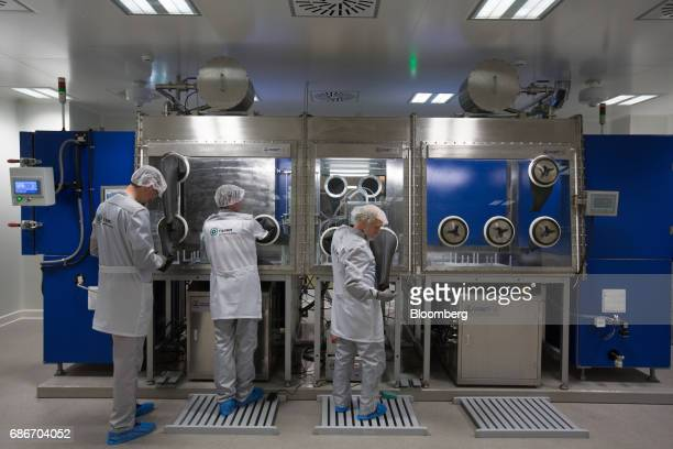 Employees demonstrate the manufacture of supercapacitor cells in the research and development laboratory at Renova Group's TEEMP production facility...