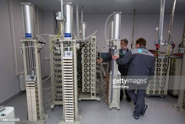 Employees demonstrate the testing of supercapacitor base cells in the research and development laboratory at Renova Group's TEEMP production facility...