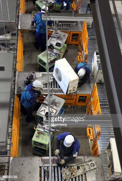 Employees dismantle Panasonic Corp air conditioning units for recycling at the Panasonic Eco Technology Center Co plant in Kato City Hyogo Prefecture...