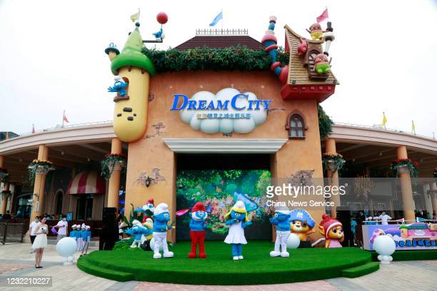 Employees dressed as Smurfs perform during the opening ceremony of the Smurfs Theme Park on May 29 2020 in Shanghai China