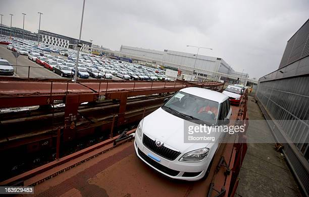 Employees drive newlymanufactured Skoda Fabia automobiles onto rail wagons transport trucks for distribution at the Skoda Autos AS plant in Mlada...