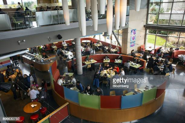 Employees eat lunch in the Commons building of the Microsoft Corp main campus in Redmond Washington US on Tuesday Dec 19 2017 In the race to...
