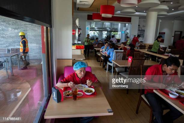 Employees eat lunch inside the canteen at the CocaCola Cambodia Bottling Plant operated by Cambodia Beverage Co which is a subsidiary of CocaCola in...