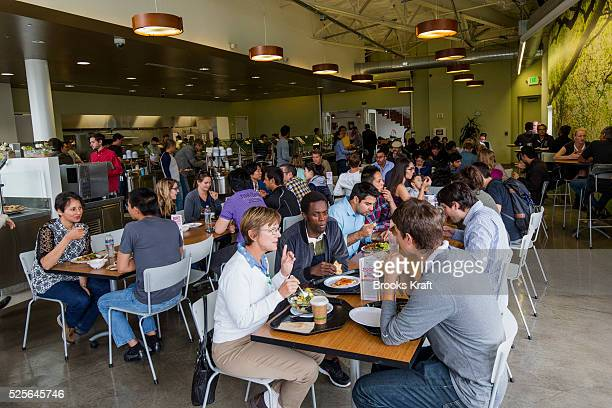 Employees eating lunch at a cafe in the Googleplex in Mountain View CA Google employees can eat breakfast lunch and dinner free of charge The...