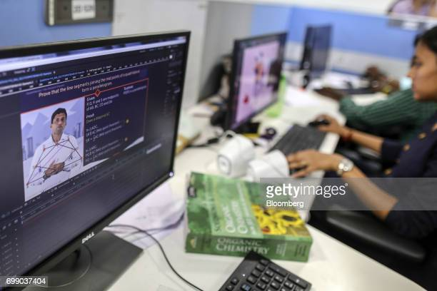 Employees edit a BYJU'S learning app video in the media department of the Thinkand Learn Pvt office in Bengaluru India on Wednesday April 5 2017...