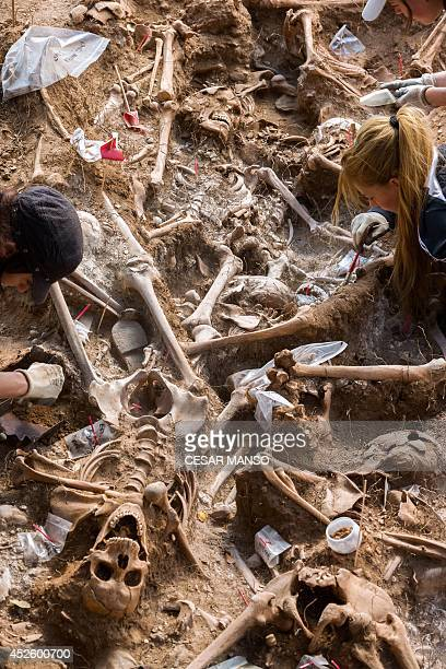 Employees exhume on Mount Estepar near Burgos on July 24 the remains of people dumped in mass graves over the summer of 1936 during the Spanish Civil...