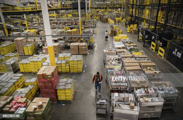 Employees fill online orders at the Amazoncom Inc fulfillment center in Robbinsville New Jersey US on Monday Nov 27 2017 The holiday shopping season...