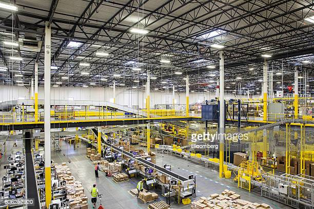 Employees fill orders and move packages inside an Amazoncom Inc fulfillment center in Robbinsville New Jersey US on Monday Nov 28 2016 In 2005...