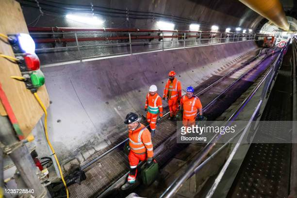 Employees follow a train through the main tunnel at the Thames Tideway Tunnel super sewer construction project in London, U.K., on Wednesday, Oct. 6,...