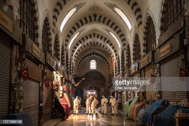 Employees from Fatih Municipality clean and disinfect Istanbul's famous Egyptian Bazaar amid the spread of the coronavirus on May 28, 2020 in...