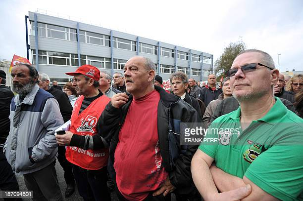 Employees from the plants of La Roche-sur-Yon and Aizenay of FagorBrandt, a French subsidiary of the Spanish electrical appliance maker Fagor, wait...