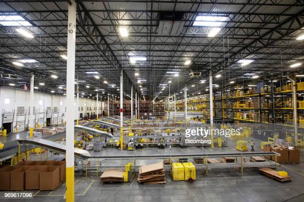 Employees fufill online orders at the Amazoncom Inc fulfillment center in Robbinsville New Jersey US on Thursday June 7 2018 Seattlebased Amazon...