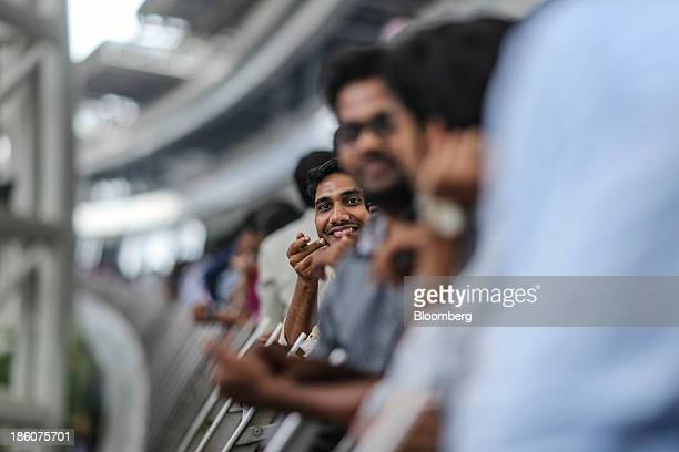 Employees gather along a corridor at the Tata Consultancy Services Ltd campus in the State Industries Promotion Corporation of Tamil Nadu Ltd IT Park...