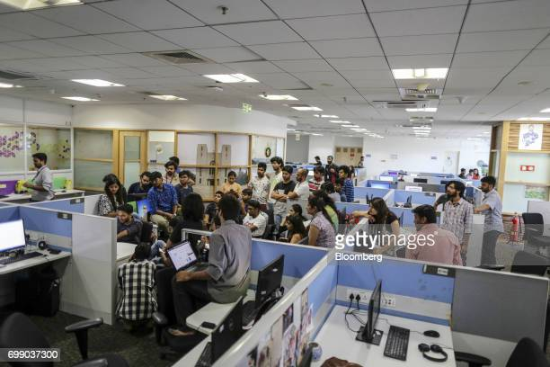 Employees gather at a storyboard meeting for the BYJU'S learning app in the Think and Learn Pvt office in Bengaluru India on Wednesday April 5 2017...