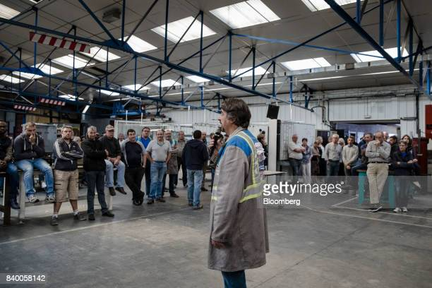Employees gather for a meeting on the future of their jobs inside the GMS automobile parts factory in La Souterraine La Creuse region France on...