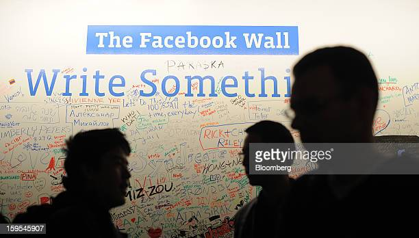 Employees gather in front of a white board at Facebook headquarters in Menlo Park California US on Tuesday Jan 15 2013 Facebook Inc introduced a...