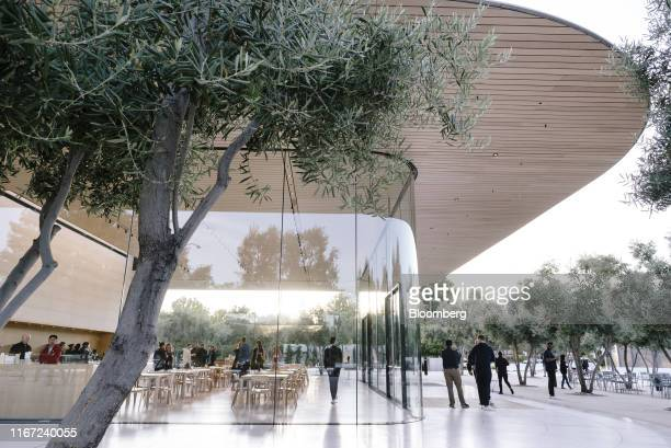 Employees gather near the Apple Visitors Center ahead of an Apple Inc event at the Steve Jobs Theater in Cupertino California US on Tuesday Sept 10...