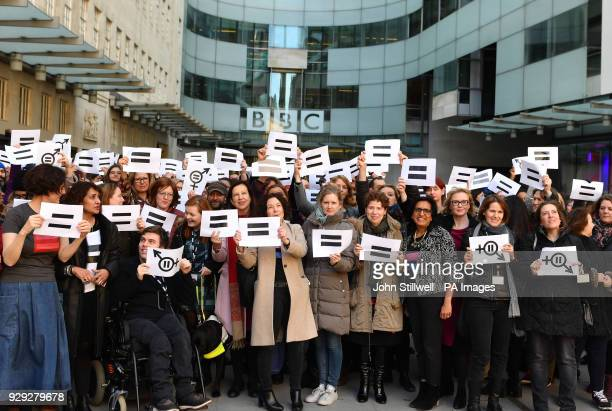 Employees gather outside Broadcasting House in London, to highlight equal pay on International Women's Day.
