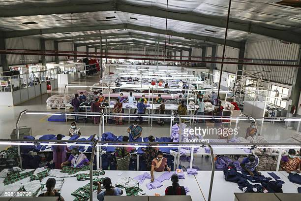 Employees handle garments on the cutting division production line at the CBC Fashions Pvt factory in Tiruppur Tamil Nadu India on Thursday Aug 4 2016...