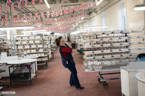 Employees handpaint crockery in the Emma Bridgewater factory which employs around 185 people and manufactures 13 million pieces of pottery each year...
