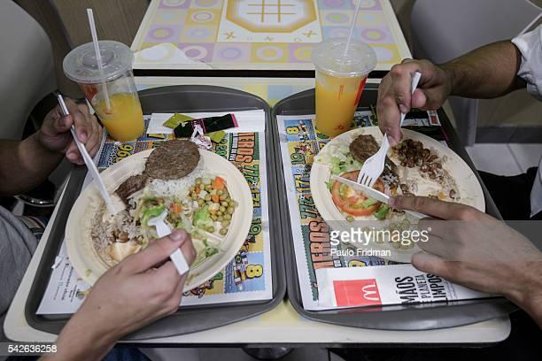 Employees have lunch at Alphaville McDonald's store, Barueri, Brazil