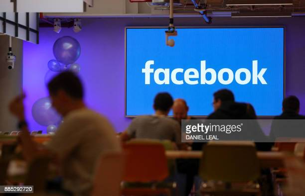 Employees have lunch at the canteen at Facebook's new headquarters designed by Canadianborn American architect Frank Gehry at Rathbone Place in...