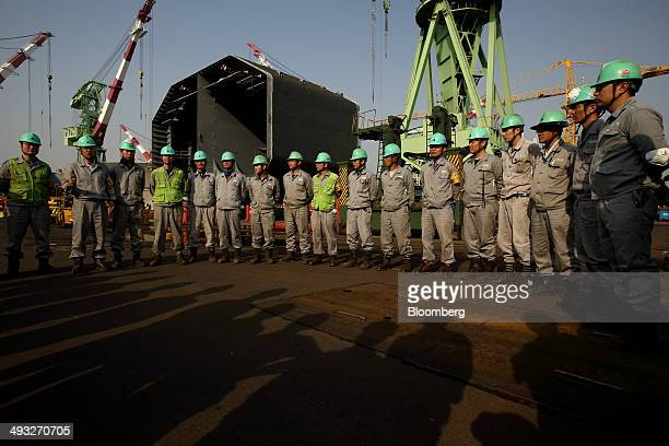 Employees hold a morning meeting at the Hyundai Mipo Dockyard Co shipyard an affiliate of Hyundai Heavy Industries Co in Ulsan South Korea on...