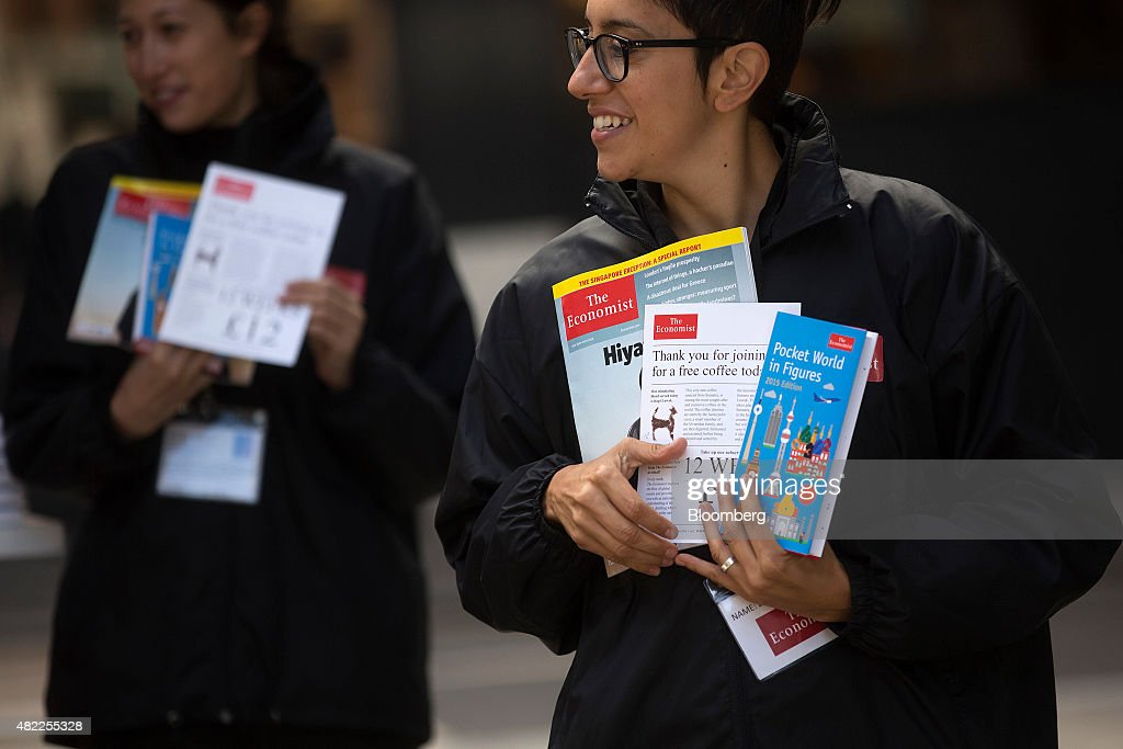 Employees hold copies of The Economist magazine and subscription information leaflets in London, U.K., on Wednesday, July 29, 2015. Pearson Plc moved closer to an exit from business publishing as it announced plans to dispose of its stake in the 172-year-old Economist magazine, just days after the sale of the Financial Times newspaper. Photographer: Simon Dawson/Bloomberg via Getty Images