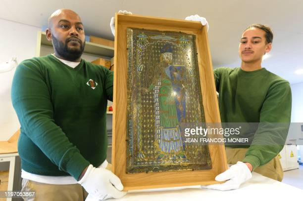 Employees hold the Plantagenet enamel representing Geoffroy V le Bel Count of Anjou and Maine Duke of Normandy founder of the Plantagenet dynasty...