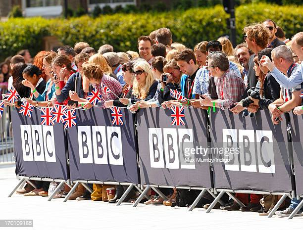 BBC employees holding union flags awaits the arrival of Queen Elizabeth II to open the new BBC Broadcasting House on June 7 2013 in London England