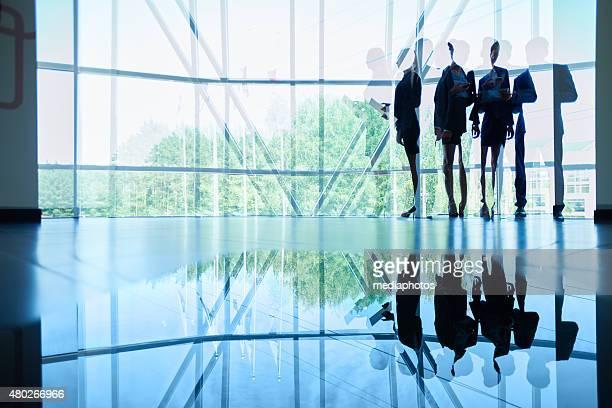 Employees in office lobby