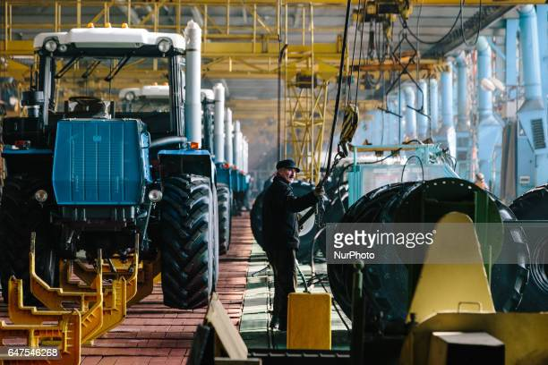 Employees in the assembly shop of the Kharkov Tractor Plant in Kharkiv on March 3 2017