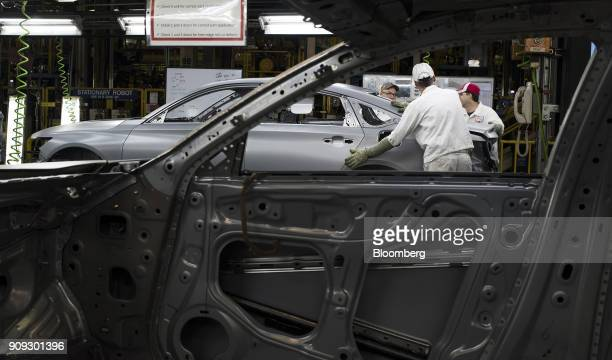 Employees inspect 2018 Honda Accord vehicles during production at the Honda of America Manufacturing Inc Marysville Auto Plant in Marysville Ohio US...