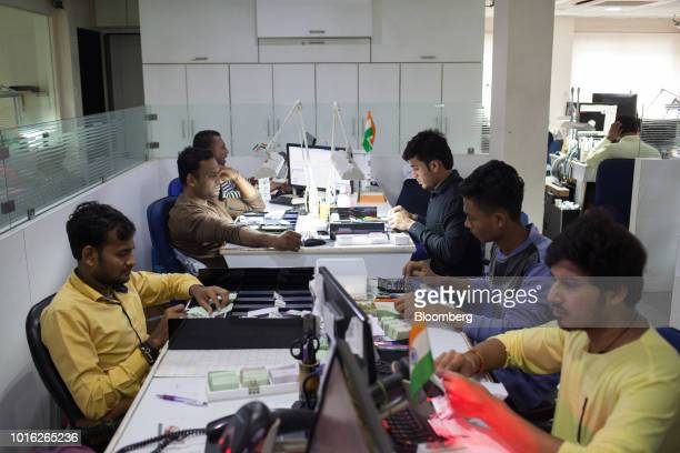 Employees inspect and analyse rough diamonds at a Virani Gems facility in Surat Gujarat India on Thursday Aug 9 2018 Diamond jewelry demand rose to a...