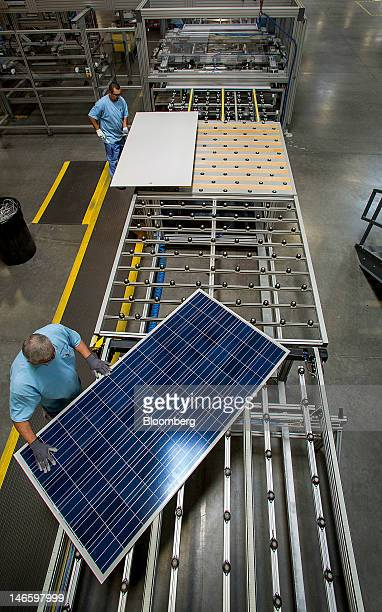 Employees inspect solar panels on the production line at the Suntech Power Holdings Co Ltd facility in Goodyear Arizona US on Monday June 18 2012...