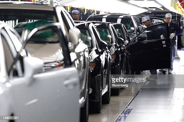Employees inspect Toyota Motor Corp Lexus vehicles on the production line of Toyota Motor Kyushu Inc's Miyata plant in Miyawaka City Fukuoka...