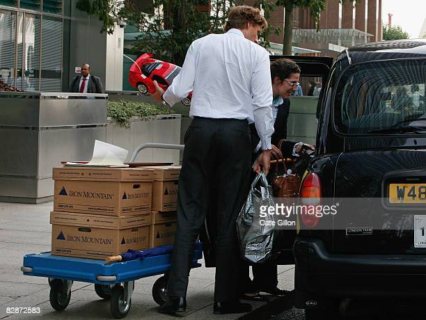 Employees leave Lehman Brothers' Canary Wharf office carrying belongings on September 15 2008 in London England The fourth largest American...