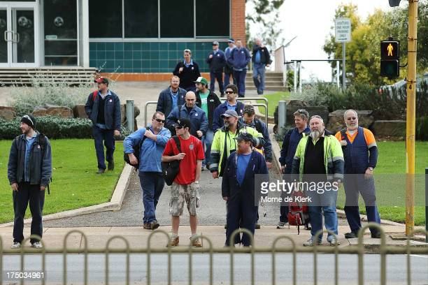 Employees leave the Holden manufacturing plant in Elizabeth on July 30 2013 in Adelaide Australia Holden a subsidiary of American car giant General...