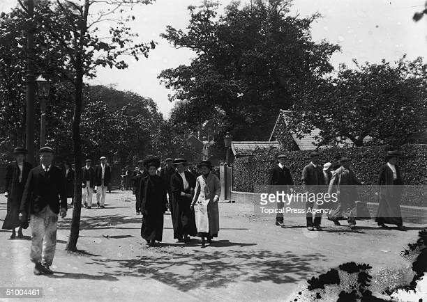 Employees leaving the Cadbury's chocolate works in Bournville Village near Birmingham a new town founded by Chocolate manufacturer and social...