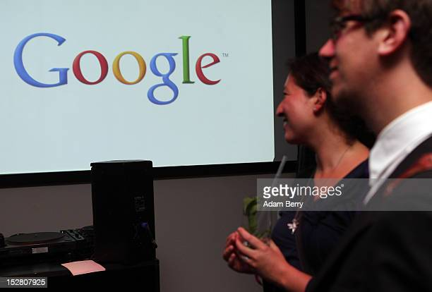 Employees listen to a speaker on September 26 2012 at the official opening party of the Google offices in Berlin Germany Although the American...