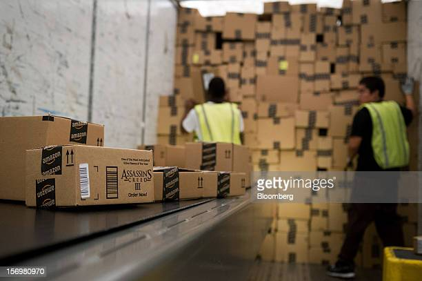 Employees load a truck with boxes to be shipped at the Amazoncom Inc distribution center in Phoenix Arizona US on Monday Nov 26 2012 US retailers are...