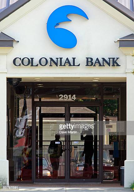 Employees lock the doors to a branch of the Colonial Bank on August 14 2009 in Montgomery Alabama According to reports BBT Bank of WinstonSalem North...