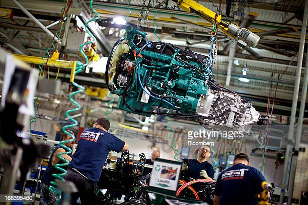 Employees lower an engine into a truck at the Volvo AG New River Valley Plant in Dublin, Virginia, U.S., on Thursday, May 2, 2013. The U.S. Census...