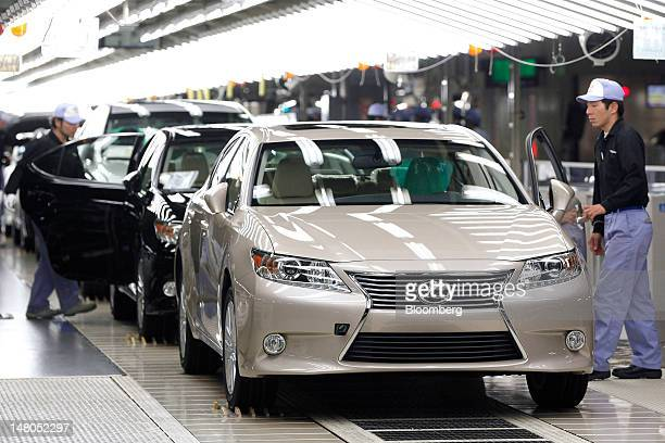 Employees make a final inspection of Toyota Motor Corp Lexus ES sedans on the production line of Toyota Motor Kyushu Inc's Miyata plant in Miyawaka...