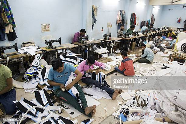Employees make cricket pads at a Stanford Cricket Industries factory in Meerut Uttar Pradesh India on Friday March 4 2016 India is set to play its...