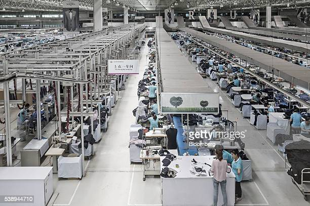 Employees make suits at a factory operated by the Shandong Ruyi Technology Group in Jining China on Monday May 30 2016 Shandong got a boost in the...